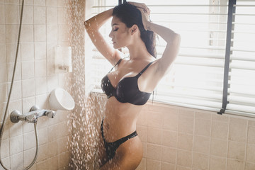 sexy asian woman on black lingerie in bathroom