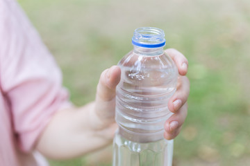 Plastic bottle with water in hand