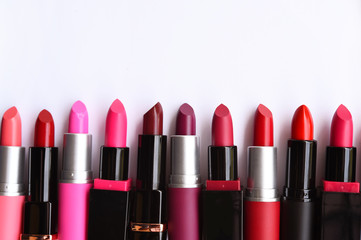 Set of color lipsticks isolated on white background