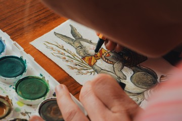 00:18 | 00:19 1×  female artist painter painting a picture of a easter bunny