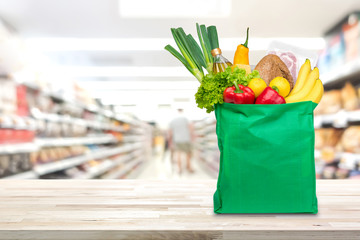 Shopping bag with food and groceries on the table in supermarket