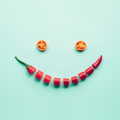 Human face smiling made from red chilli.creativity food concepts