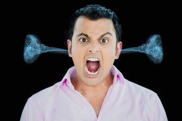 Closeup portrait, bitter, displeased pissed off, angry grumpy man in pink shirt, open mouth, screaming and yelling, smoke coming from ears isolated black background.