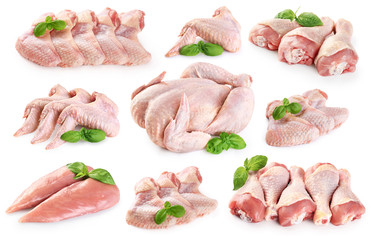 Foto auf Acrylglas Fleisch Fresh raw chicken and chicken parts isolated on white background. Breast, wings and legs.