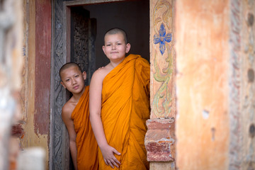 Two novices are looking in the temple of Buddhism in Thailand in Asia.