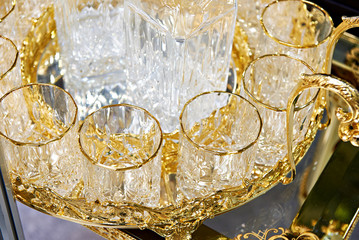 Glass cups for drinks with golden decor