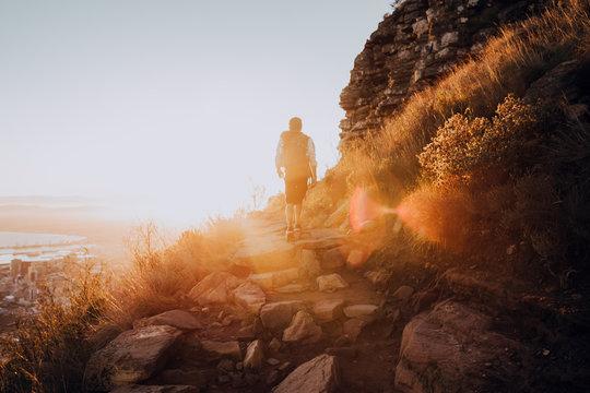 Hiker on mountain at sunrise