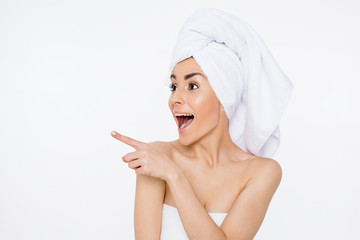 Beautiful smiling woman with a towel on her head after showering. Cosmetology. Women Health