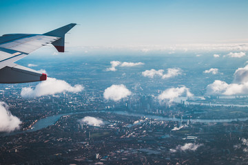 aerial view from the airplane over london central city and river themse