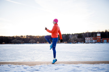 Portrait of sports girl on morning exercise in winter