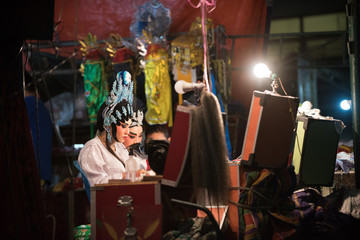 Bangkok, Thailand - April 8, 2018 : Actor make up for the performance Chinese opera. Chinese opera is an ancient drama musical way in China Town at Sathupradit district Bangkok, Thailand.