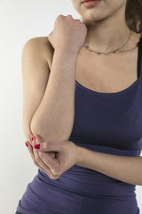 A young woman is struggling with pain, isolated on background