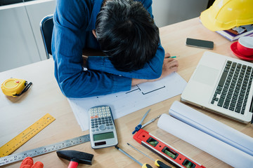 Engineerman suffering stress working at office asking for help feeling tired.