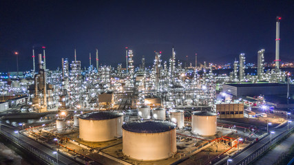 Aerial top view oil and gas refinery factory and Petrochemical plant at night.