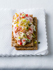 Crispbread with curd and sprouts