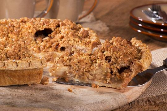 Closeup of serving a slice of Dutch apple pie