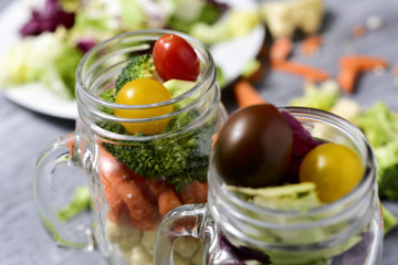 salad served in some mason jars