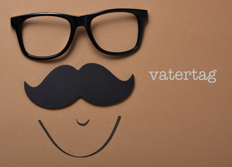 man face and text vatertag, fathers day in german