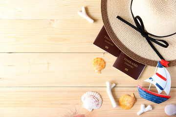 Beach hat,sailboat and glasses on wood background In the summer Asia,copy space,Top view,minimal style