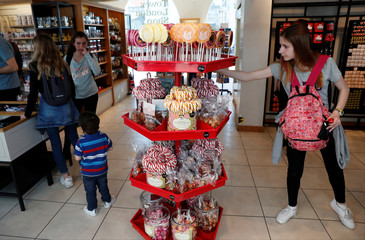 A tourist looks at Candy lollipops on sale in The Tower of London souvenir shop in London