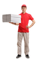 Teenage delivery boy holding pizza boxes