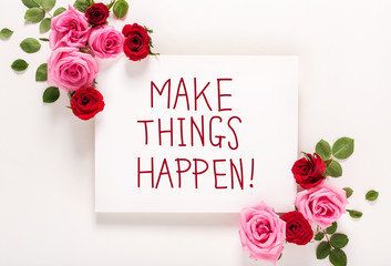 Make Things Happen message with roses and leaves top view flat lay