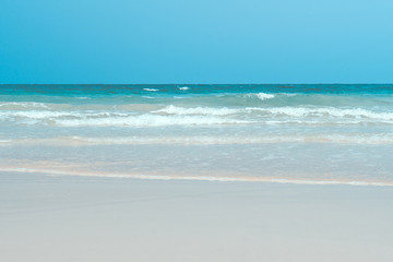 background of a white sandy beach with a turquoise sea