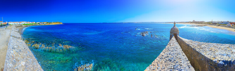 Wonderful romantic afternoon panoramic seascape. Coastline cliffs of the Atlantic ocean in Peniche. Quebrado and Gamboa Beach from medieval fortress. West coast of Portugal at sunny weather.
