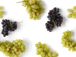 Fototapete - Black and green grapes isolated on a white background. The pattern of grapes of different varieties, top view. Food background.