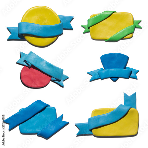 Clay putty, plasticine handmade shapes, badges with ribbons