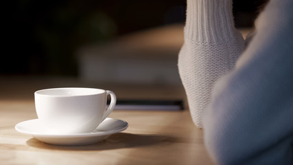 White tableware in cafe, woman drinking cup of hot tea at restaurant, relax