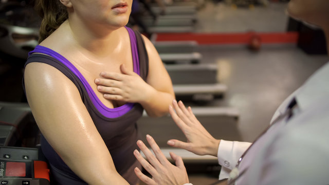 Therapist helping woman to calm down and recover breath after active workout