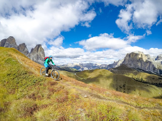 Woman Mountain Biking in the Dolomites, Val Gardena, South Tyrol, Italy