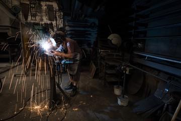 Blacksmith using a welding torch