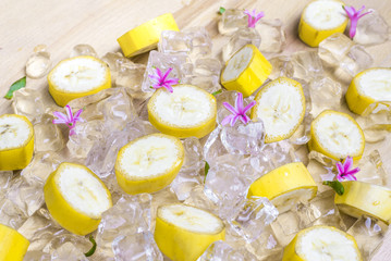 Pieces of ripe banana with peel on ice as a very icy refreshment
