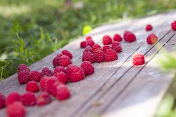 raspberries on a wooden board