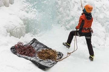 Rock climber climbing mountain during winter