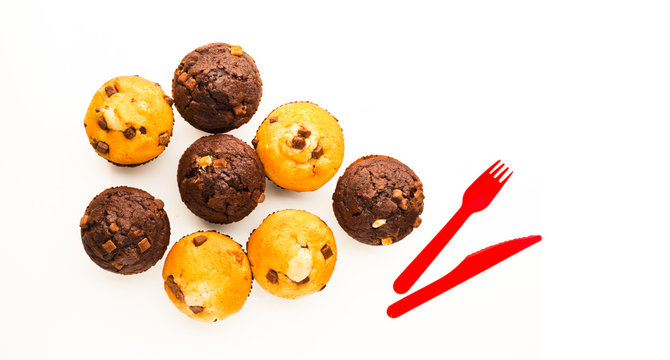 Muffins on white reflective surface