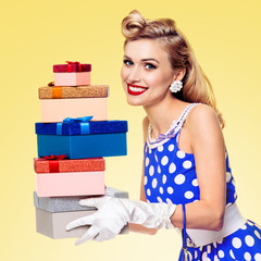 Woman in pin-up style dress with gift boxes