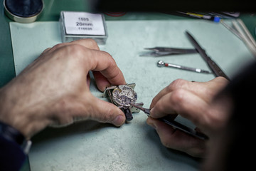 Close Up shot of a Watchmaker at Work