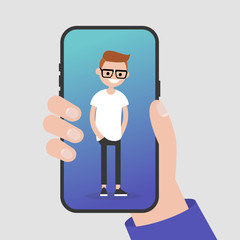 Hand holding a smartphone. Millennial character standing on a mobile phone screen. Flat editable vector illustration, clip art