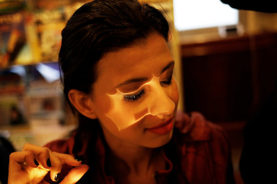 Keilane, who is visually impaired and has 20 percent of vision, applies false eyelashes during a cosmetics class set up to help boost self-esteem at the Laramara association in Sao Paulo