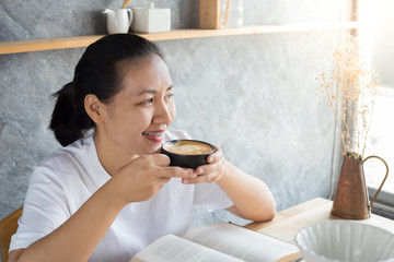 reading book with coffee