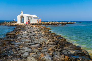 Small white Saint Nicolas chapel by the sea at Georgioupoli in Chania, Crete, Greece