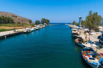 Fishing boats at Kournas lake in Georgioupoli village in Chania, Crete, Greece. It is the only freshwater lake on Crete which is fed by streams from the nearby mountains and hills