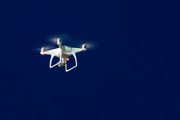 technology drone flying in the blue sky for take a photo and video bird view