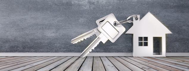 Schlüssel mit Anhänger in Hausform