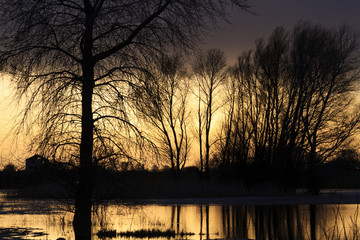 mystical sunset in spring flood waters