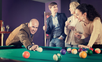 Happy middle class people having pool game