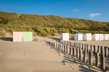 Pastel colored beach huts on the beach of Domburg, the Netherlands
